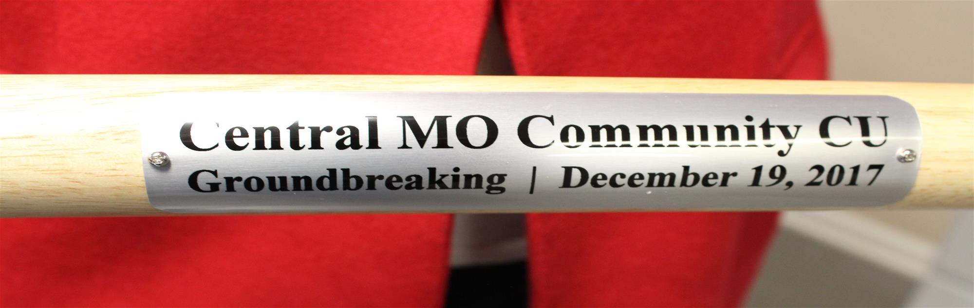 "Shovel Handle with wording stating ""Central MO Community CU Groundbreaking December 19, 2017"""
